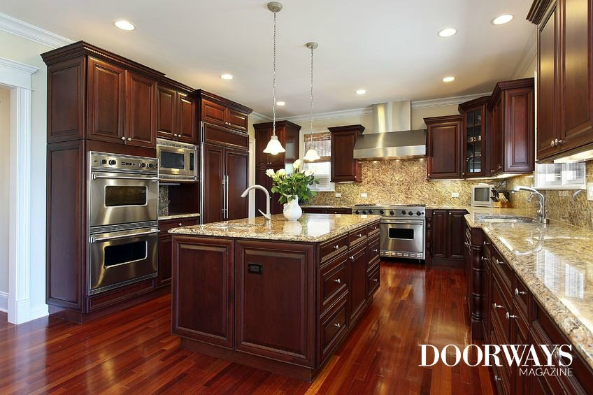 kitchen with dark cabinets and hardwood floors
