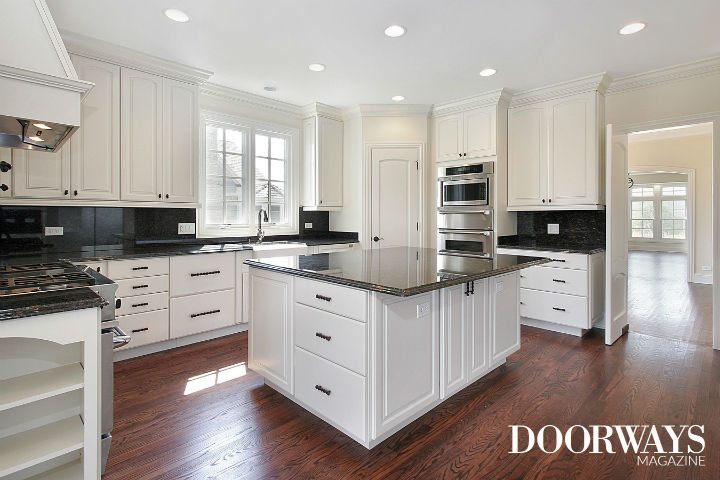 white kitchen cabinets black marble countertops