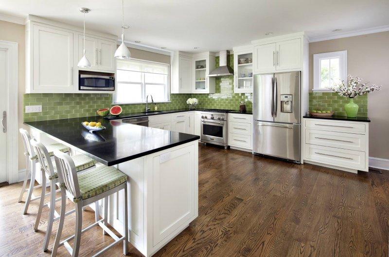 white kitchen green backsplash
