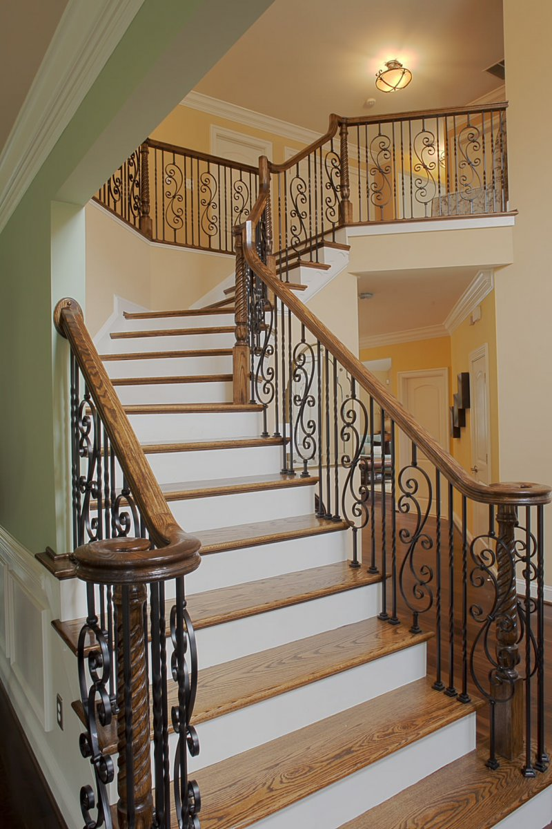 Wood Stairs With Wrought Iron Railing